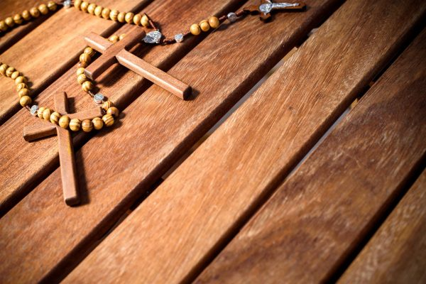 Christian symbols for religious believers, wooden background.